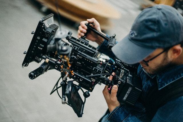 Man handling a video camera